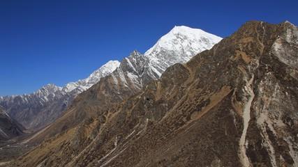 Langtang Lirung, high mountain of the Langtang Himal range. Kyangjin Ri, viewpoint abobe Kyangjin Gumba, Nepal. Spring day.