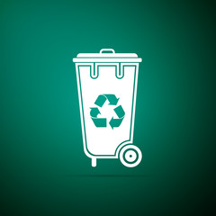 Recycle bin with recycle symbol icon isolated on green background. Trash can icon. Flat design. Vector Illustration
