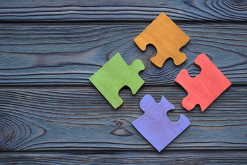 The four parts of the color puzzle are assembled into one. The idea of a business concept, cooperation, teamwork, strategy