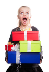 child with a lot of gift boxes in hands on isolated background