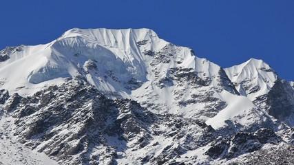 Mountain peak of Naya Kanga covered by thil glacier and snow. View from Kyanjin Gumba, Langtang National Park, Nepal.