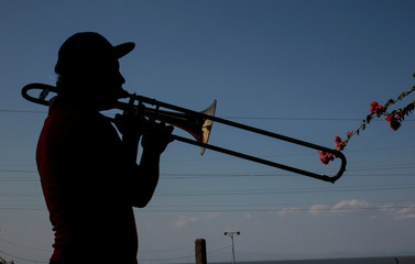 A music student plays the trombone at the music school in Managua