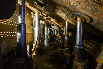 Underground coal ore mine shaft tunnel gallery with harvester coal combine miner
