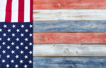 US Flag and national colors on rustic wooden planks for holiday background