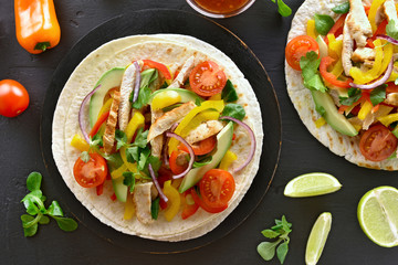 Tacos with chicken meat and vegetables