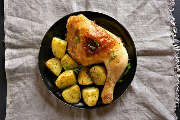 Roasted chicken leg with potato