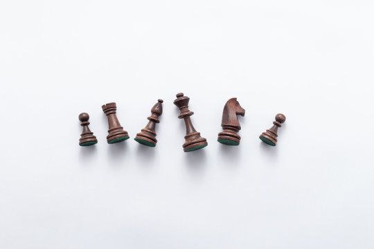 Chess game figures on white background , top view, flat lay