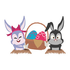 Cute rabbits with easter eggs basket cartoon vector illustration graphic design