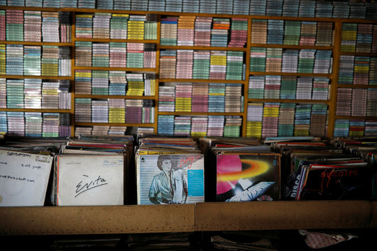 "Vinyl records and tapes are seen at ""El Pollo Musical"" (The Musical Chicken) record store in San Salvador"