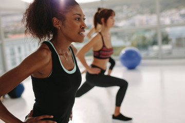 Woman exercising in gym class