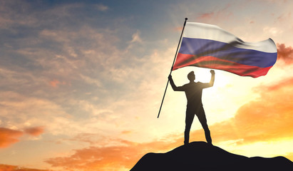 Russia flag being waved by a man celebrating success at the top of a mountain. 3D Rendering