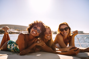 Group of beautiful women relaxing on a yacht deck