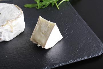 cheese brie stone background black dark