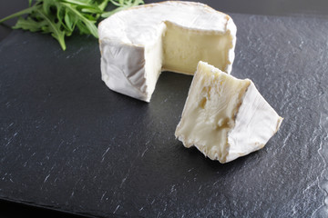 cheese brie stone background black dark