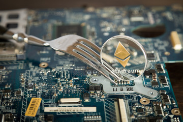 Ethereum Digital Cryptocurrency Hard Fork Change Concept. Virtual Crypto Currency Coin On Computer Mohterboard.