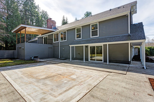 Gray home exterior with patio area