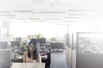 Asian woman in the old office, Bangkok, Thailand.