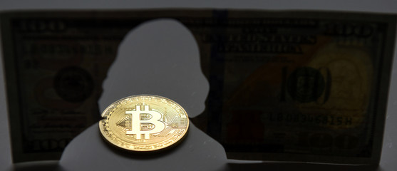 New world currency. Gold coin of Bitcoin and silhouette of Benjamin Franklin Franklin on the one hundred dollars USA. Bitcoin concept. Money concept.