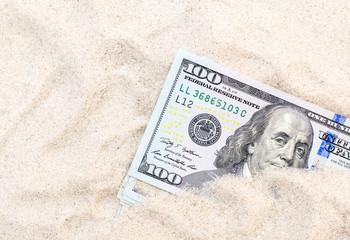Money hidden in the sand.