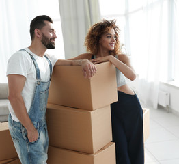 couple standing next to boxes when moving to a new house