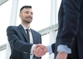 closeup. handshake business partners after bargain