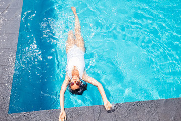 Woman relax in swiming pool on luxury resort