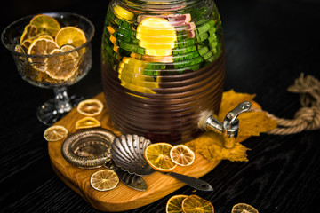 Lemonade or mojito cocktail with lemon, orange, grapefruit and mint, cold refreshing drink or beverage with ice