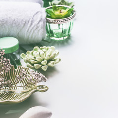 Green Spa treatment setting on white background with copy space