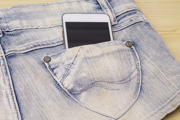 Blue short jeans with mobile phone in your pocket