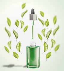 Green facial Serum or oil bottle with pipette and green leaves. Modern skin care and beauty natural cosmetic concept