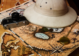 pith helmet and maps