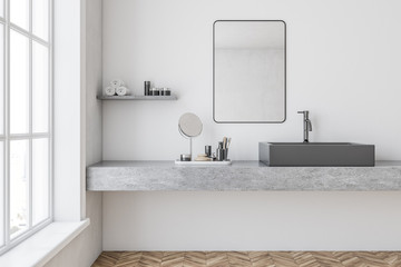 Gray sink in a white bathroom