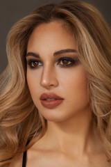 Gorgeous blonde woman portrait with brown eyes looking aside