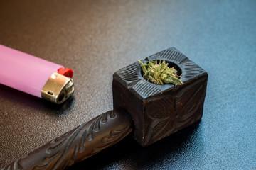 Wooden tobacco pipe and cigarette lighter, hemp for smoking. smoke marijuana. Cannabis Smoking Pipe.