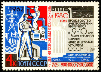 Ukraine - circa 2018: A postage stamp printed in USSR show propaganda poster Electric industry and statistics. Forecast until 1980. Series: Resolution of 22nd Communist Party Congress. Circa 1962
