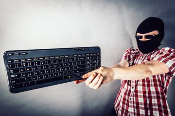 Man wearing balaclava shooting from keyboard