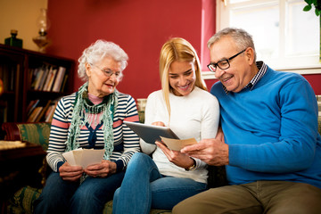Grandparents compare photos from youth with digital photos from granddaughter