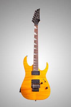 The image of a yellow electric guitar