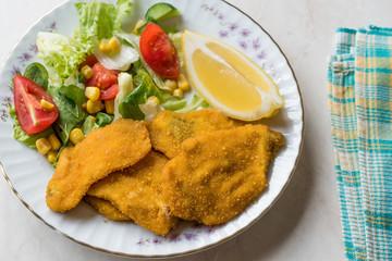 Fried Crispy Sardine Fish Plate with Salad and Lemon / Seafood Sardalya