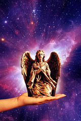 Wall Mural - angel archangel statue on female hand like a concept of guardian angels and archangel protection