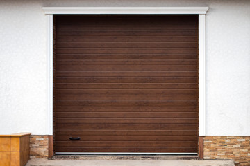 Wooden wall of modern rural garage with the automatic lifted gate