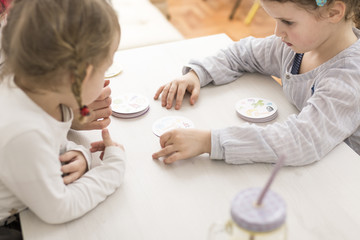 Couple of Kids Playing with Flash Cards on a Table