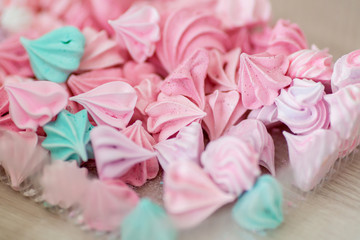 Many sweet biscuit meringue of different colors in box