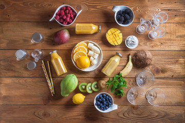 Fresh smoothie, Variety of fruits, leaves, seeds and berries on rustic wooden background, top view.  Clean eating, detox, dieting, vegetarian, vegan, fitness, healthy lifestyle concept