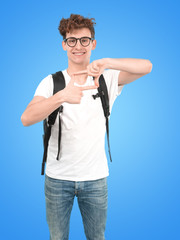 Confident young student doing a gesture of frame with his hands