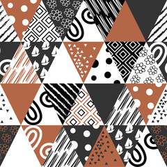 Abstract geometric seamless pattern of triangles. Texture for fabric and wallpaper. Vector illustration.