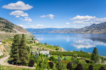 View of the Okanagan Lake under Blue Sky on a Sunny Summer Day and Reflection in Water. Penticton, BC, Canada.