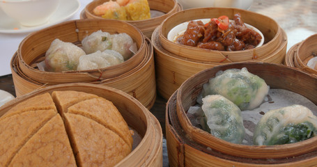 Eating chinese dim sum in outdoor restaurant