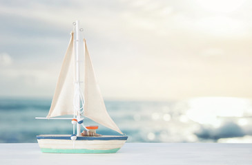 nautical concept with white decorative boat over tropical sea landscape background.