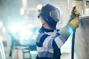 Professional engineer of shipbuilding factory welding details of new metallic boat